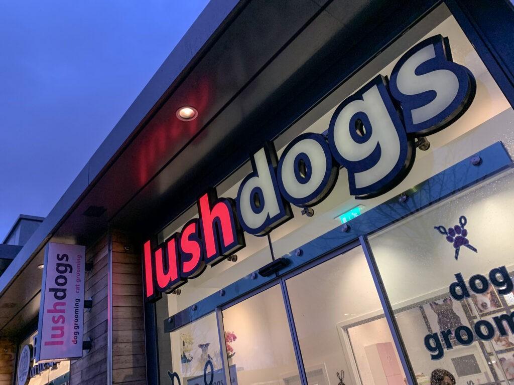 Lush Dogs illuminated window sign