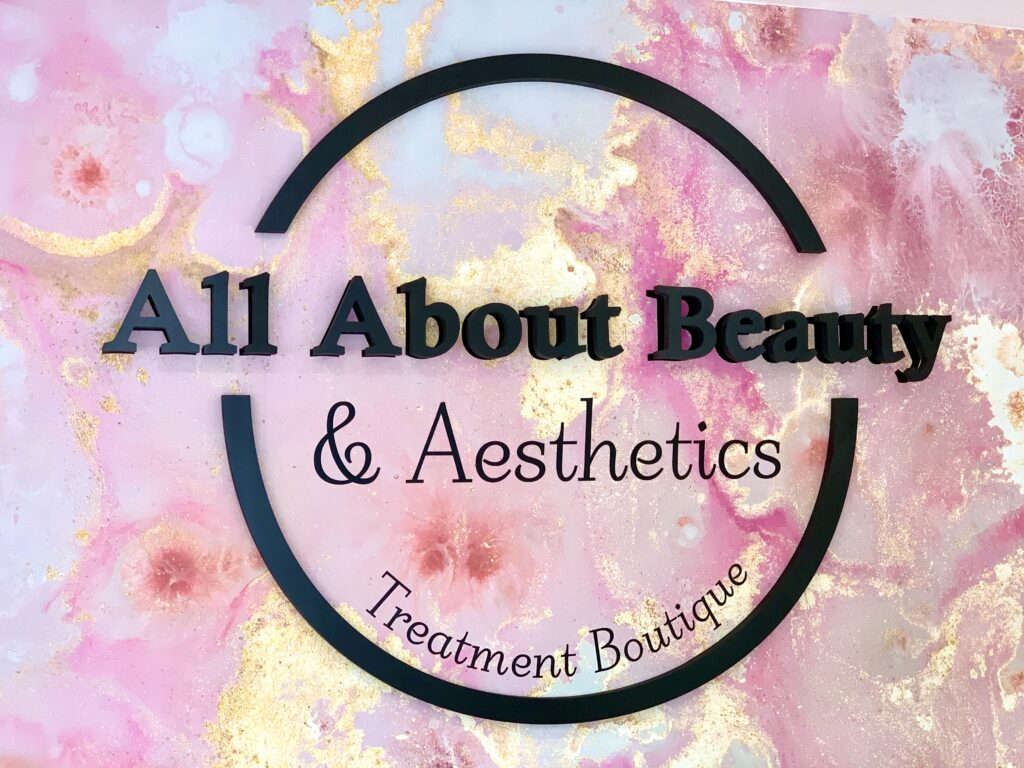 All About Beauty wall logo interior signo
