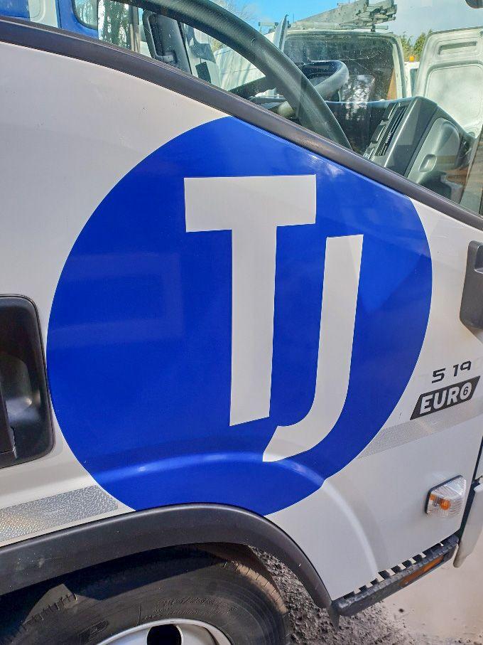 TJ Transport vehicle logo