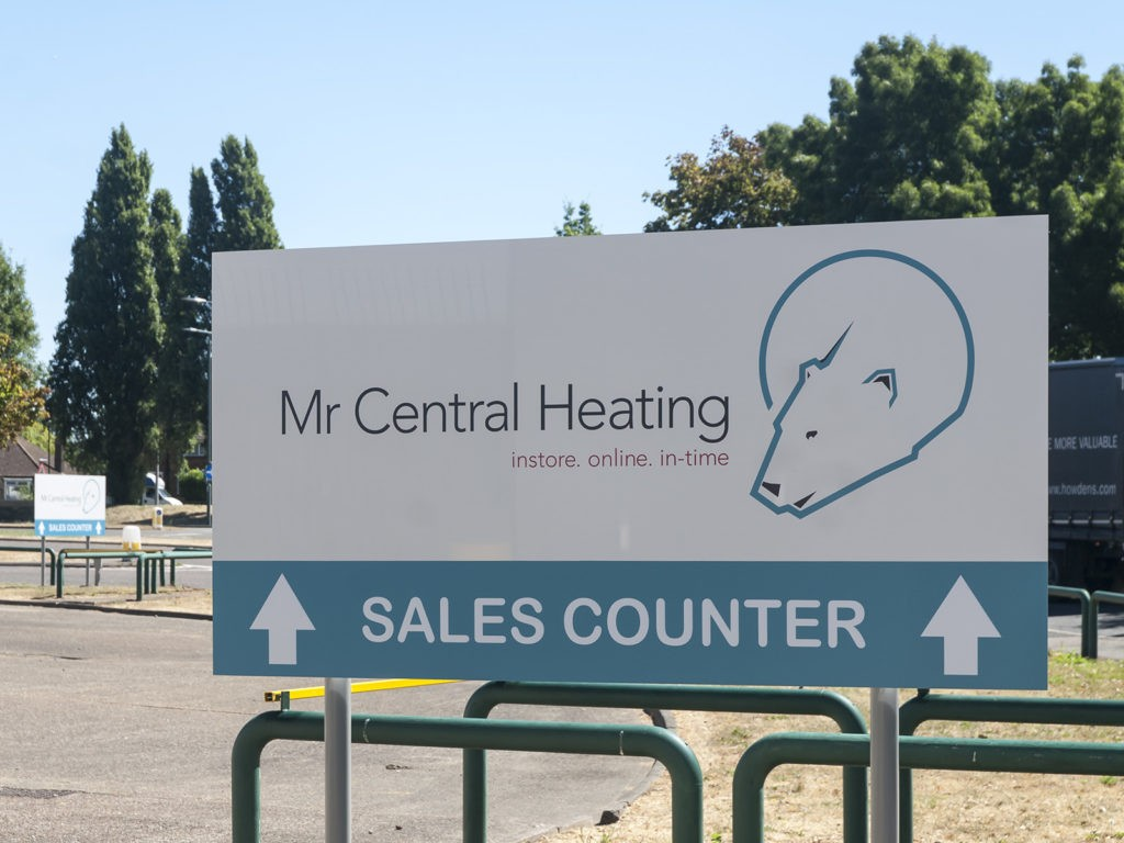 Sales entrance waypoint post signs at Mr Central Heating, Erith