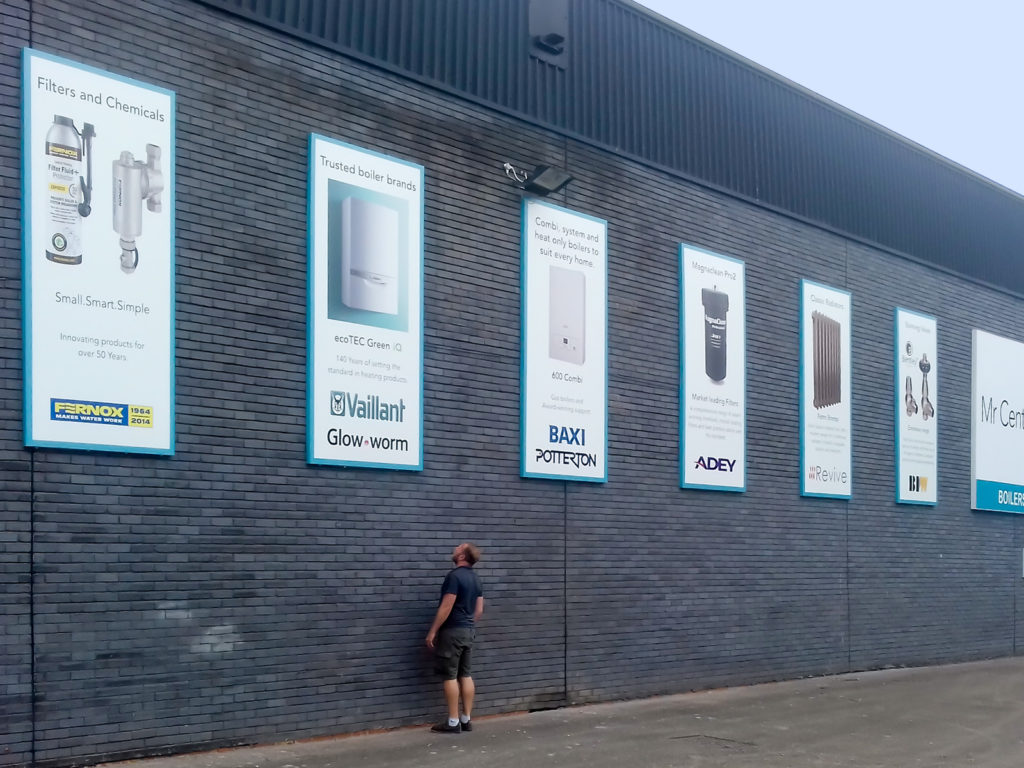 Large aluminium composite advertising boards at Mr Central Heating, Erith