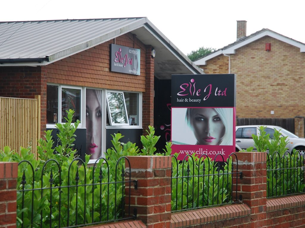 Hanging main sign, post sign, and one way vision digitally printed window graphic at Elle J - Gosport