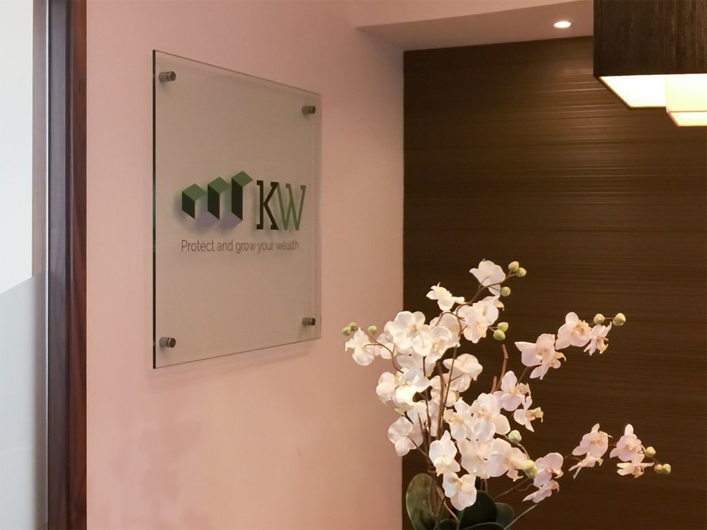 10mm glass panel with applied digital graphics at KW Wealth, London