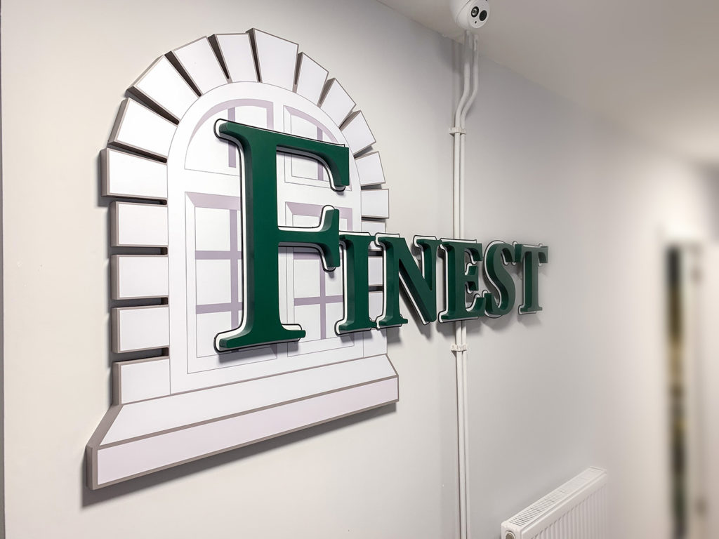 Finest Group internal wall sign