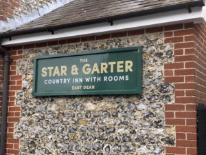 Traditional painted wooden sign with gut vinyl graphics at Star & Garter, East Dean