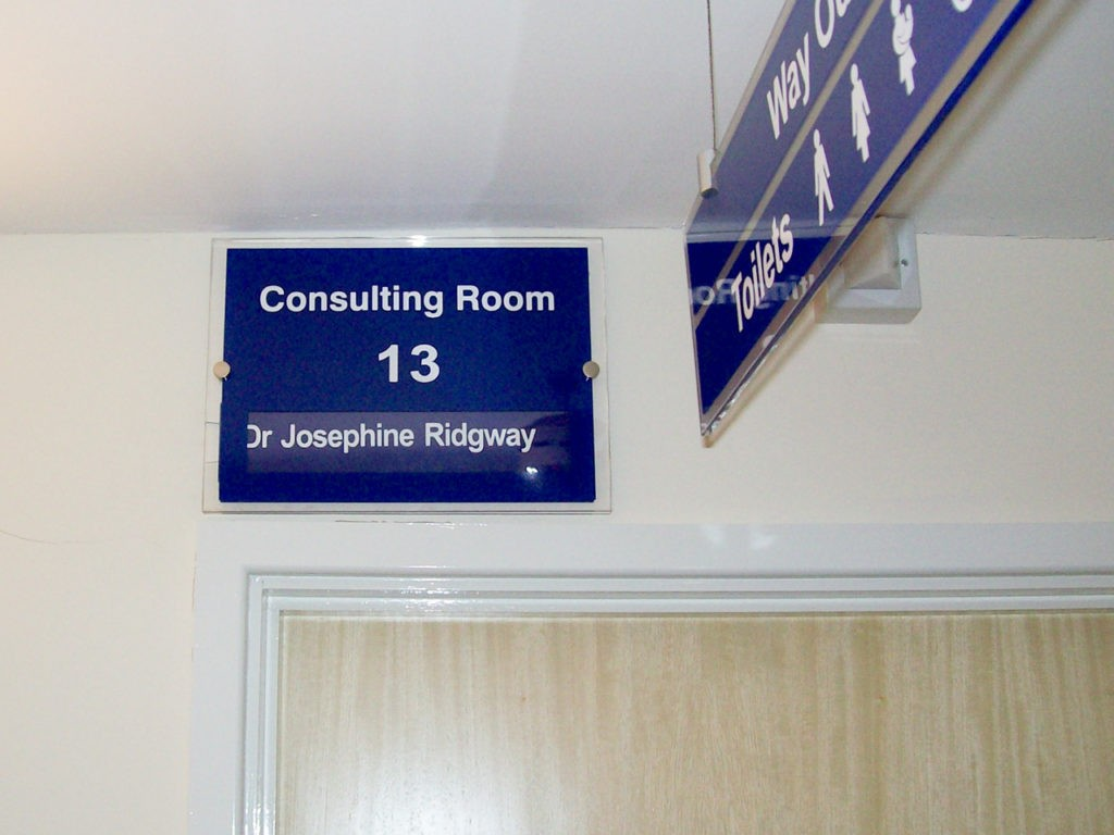 Hanging and office waypoint signs at Bosmere Medical Centre, Havant