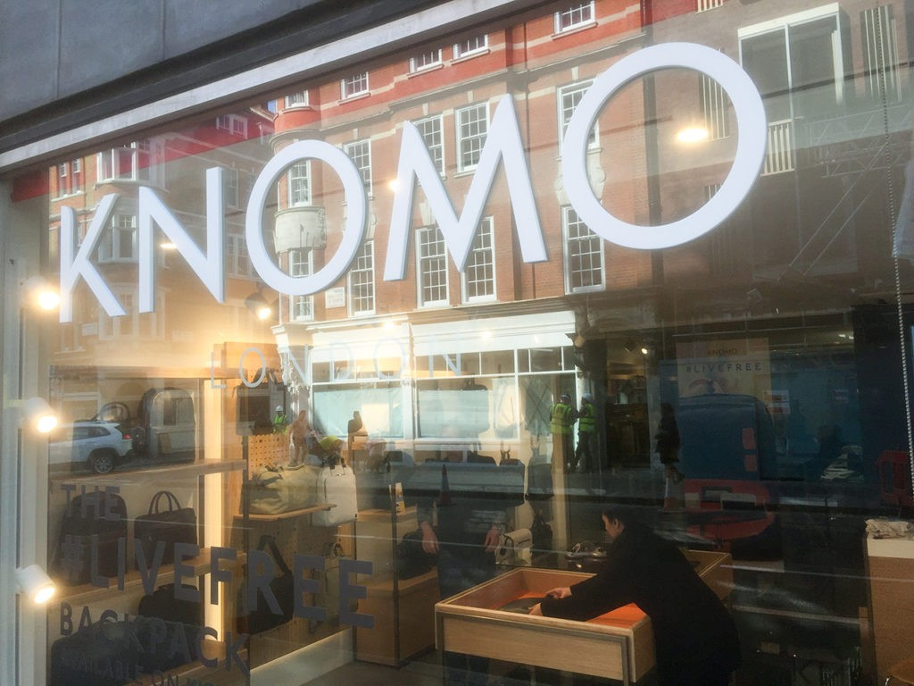 Main Knomo logo fitted to the glass at Great Portland Street, London