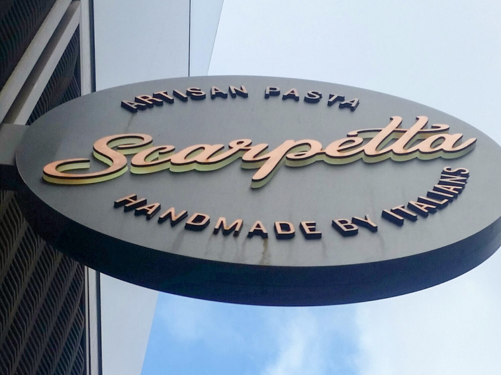 Projecting sign with 3D wording at Scarpetta, Candlewick, London