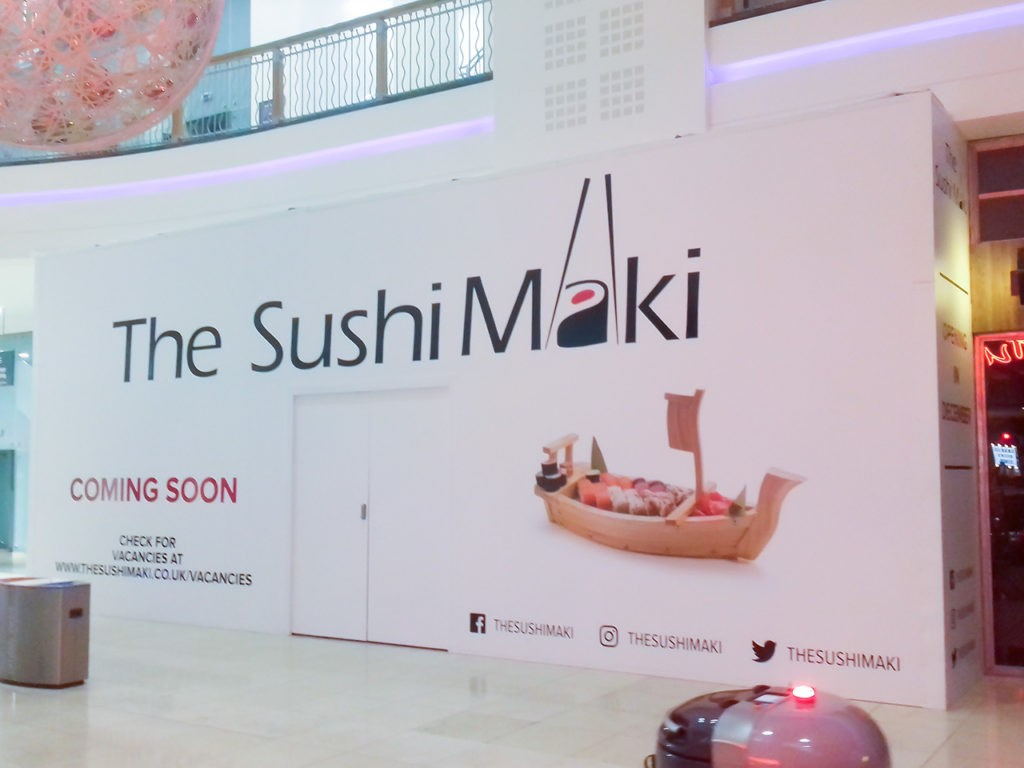 The completed graphics on the right and front of the hoarding at The Sushi Maki, Basingstoke