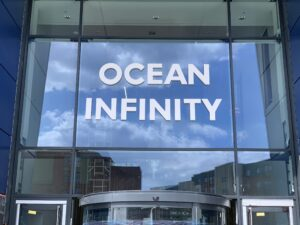 Ocean Infinity text, stuck directly to the glass front