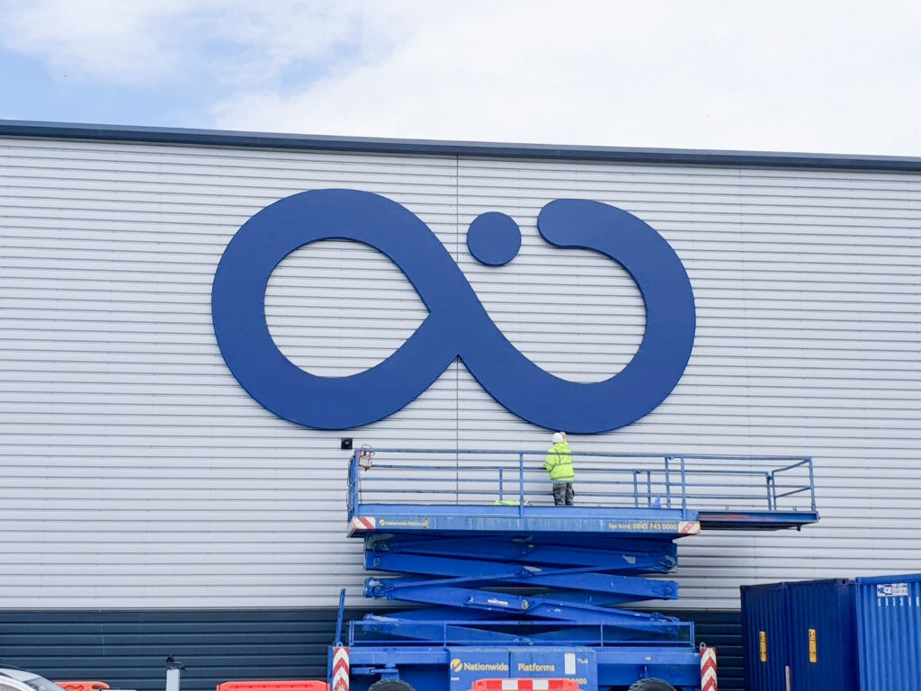 The larger infinity sign with face fitted. A person for scale.
